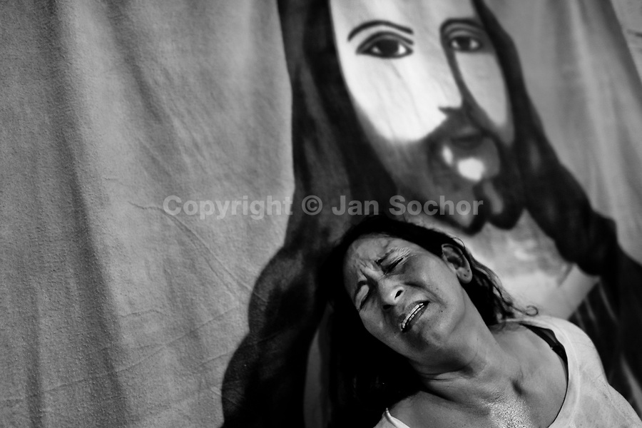 A Colombian woman cries of pain while being allegedly possessed by demons during the exorcism ritual performed at a house church in Bogota, Colombia, 10 March 2016. Hundreds of Christian belivers, joined in nameless groups, gather every week in unmarked home churches dispersed in the city outskirts, to carry out prayers of liberation and exorcism. Community members and their religious activities are usually conducted by a charismatic pastor or preacher. Using either non-contactive methods (reading religous formulas from bible, displaying Christian symbols and icons) or rough body-pressure-points techniques and forced burping, a leading pastor commands the supposed evil spirit, which is generally believed to come from witchcraft, to depart a person's mind and body. The demon's expulsion often consists of multiple rites and may last for several months.