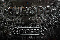 An embossed logotype (Europa) seen on the letterpress machine in the print shop in Cali, Colombia, 1 June 2012. Letterpress printing, invented by Johannes Gutenberg in the 15th century, remained the primary way to print and distribute information until the second half of the 20th century. The process of letterpress printing consists of composing movable types into the bed of a press, inking it, and pressing paper against it to create an impression. Nowadays, due to the offset printing expansion, there are few commercial print shops in the world keeping this traditional craftsmanship alive.