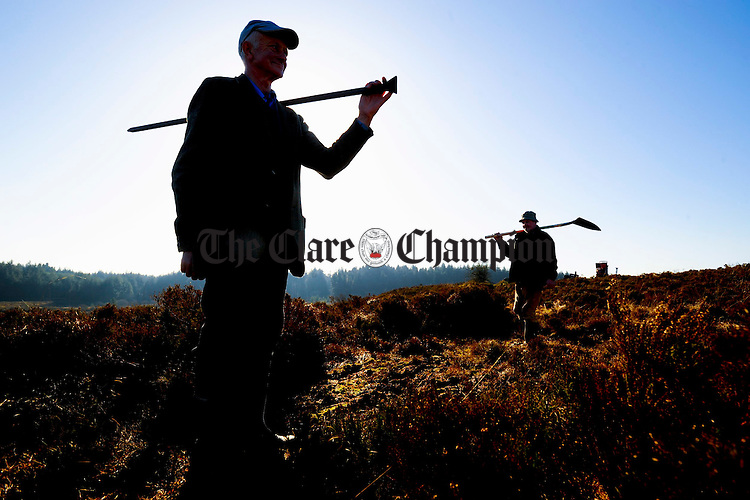 Time to gather the tools and head down the mountain for workers finishing their day on  the Feakle Rural Social Scheme on top of Ballycroum mountain in Feakle. Photograph by John Kelly.