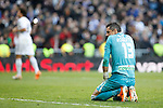 Granada´s goalkeeper Roberto complains while Real Madrid´s players celebrate a goal during La Liga 2013-14 match in Santiago Bernabeu stadium in Madrid, Spain. January 25, 2014. (ALTERPHOTOS/Victor Blanco)
