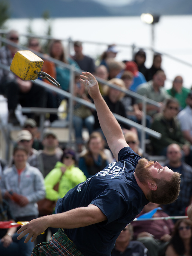 Spencer Tyler competes in the weight for height event during the 2015 Alaska Scottish Highland Games at the Palmer fairgrounds.