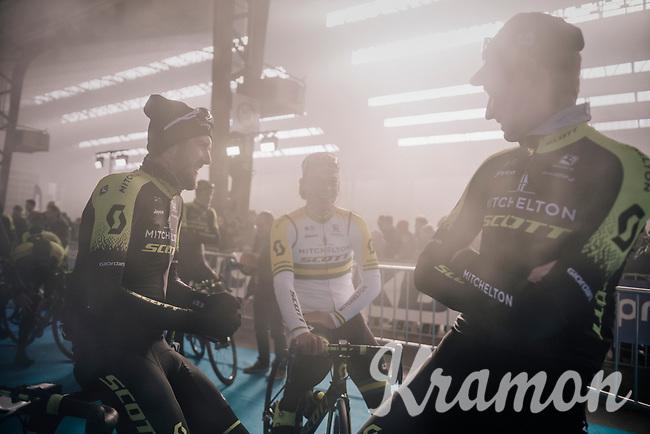 Luke Durbridge (AUS/Michelton-Scott), Alexander Edmondson (AUS/Michelton-Scott) & Lucas Hamilton (AUS/Mitchelton-Scott)  waiting (in the podium smoke) for the pre-race team presentation in the legendary Kuipke Velodrome<br /> <br /> <br /> Omloop Het Nieuwsblad 2018<br /> Gent › Meerbeke: 196km (BELGIUM)
