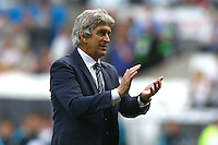 Manchester City manager Manuel Pellegrini applauds the City fans at full time during the Barclays Premier League match between Swansea City and Manchester City played at The Liberty Stadium, Swansea on 15th May 2016