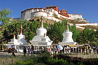 At the Three Chortens, Buddhist pilgrims can continue north on the Lingkor, a pilgrim circuit around the old city of Lhasa, or turn eastward to complete the Tsekor, a sacred circuit around the outer walls of the Potala Palace, Lhasa, Tibet, China.