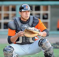 Catcher Jesus Navarro of the Augusta GreenJackets, Class A affiliate of the San Francisco Giants, in a game against the Greenville Drive on April 7, 2011, at Fluor Field at the West End in Greenville, South Carolina. (Tom Priddy / Four Seam Images)