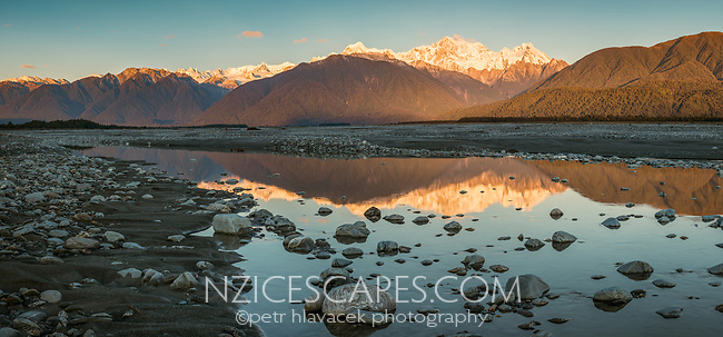 Sunset over Mt. Cook and Mt. Tasman of Southern Alps with reflections in Cook River, Westland National Park, West Coast, World Heritage Area, South Westland, New Zealand