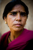 Sampath Pal Devi, 52 commander of the Pink Gang, poses for a photograph in Village of District Banda in Uttar Pradesh, India. This band of vigilantes, called the Gulabi Gang (pink gang) - its 10,000 strong women memberswear only pink sarees - is taking up cudgels against domestic violence and corruption...Amidst the gloom of extreme poverty, it's the colour of pink that's calling the shots in this dusty region of Bundelkhand, one of the poorest parts of one of India's northern and most populous states, Uttar Pradesh in India. A gang of vigilantes, called the Gulabi Gang (pink gang) - its 10,000 strong women members wear only pink sarees - is taking up lathi (traditional Indian cudgel) against domestic violence and corruption. ..The 47-year-old leader of the Pink Gang, Sampat Pal Devi is a fiesty woman. The barely educated, impoverished mother of five, Sampat Pal Devi has emerged as a messianic figure in the region. Sampath Devi began to work as a government health worker, but she quit soon after because her job was not satisfying enough. She always wanted to work for the poor and not for herself. Taking up issues while being a government worker was difficult, so she decided to quit the job and work for the rights of people.