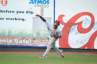 Greeneville Reds right fielder Reniel Ozuna (27) throws the ball back to the infield during the game against the Pulaski Yankees at Calfee Park on June 23, 2018 in Pulaski, Virginia. The Reds defeated the Yankees 6-5.  (Brian Westerholt/Four Seam Images)