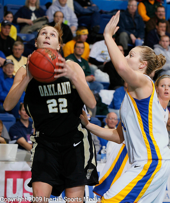 SIOUX FALLS, SD - MARCH 10:   Brittany Carnago #22 of Oakland University shoots past Jennifer Warkenthien #44 of South Dakota State during the Summit League Championship women's basketball game Tuesday afternoon at the Sioux Falls Arena. (Photo by Dick Carlson/Inertia)