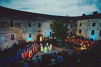 "Vyborg, Russia, 27/06/2002..The mid-summer White Nights period when the sun sets only briefly is a time of festivals &  entertainment. The Kirov Opera presents a new production of Mussorgsky's ""Boris Godunov"" in Vyborg Castle courtyard.."