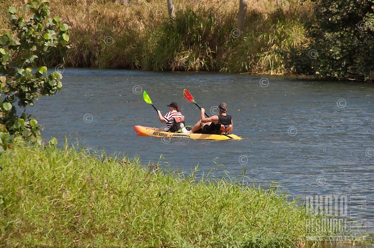 Kayakers on the Wailua River, Kauai.