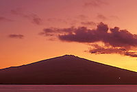 Beautiful sunset over Haleakala (House of the Sun) mountain on Maui, shot from the shore on the island of Kahoolawe.