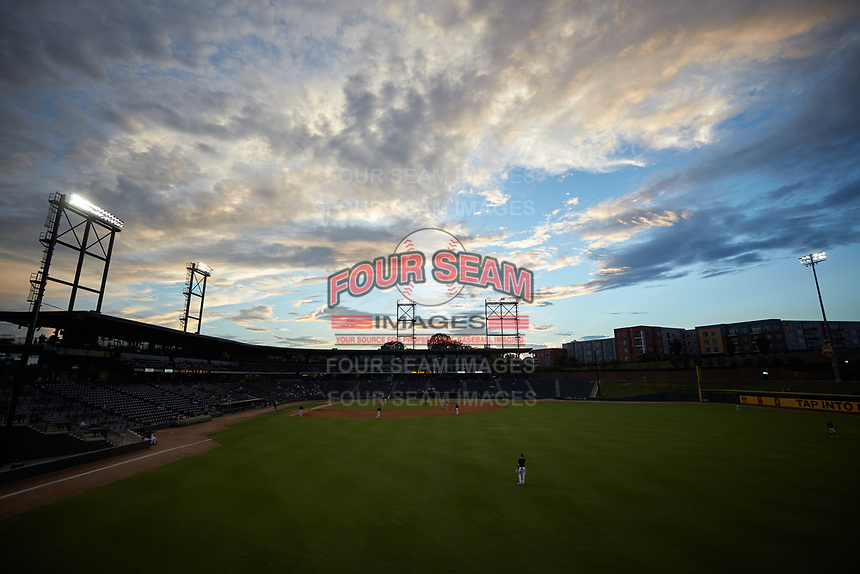 The sun sets over BB&T Ballpark during the Carolina League game between the Wilmington Blue Rocks and the Winston-Salem Warthogs on July 17, 2019 in Winston-Salem, North Carolina. The Blue Rocks defeated the Warthogs 4-1. (Brian Westerholt/Four Seam Images)