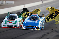 Oct 27, 2017; Las Vegas, NV, USA; NHRA funny car driver John Force (right) crosses the centerline alongside Jim Campbell during qualifying for the Toyota National at The Strip at Las Vegas Motor Speedway. Mandatory Credit: Mark J. Rebilas-USA TODAY Sports