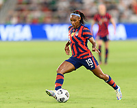 AUSTIN, TX - JUNE 16: Crystal Dunn #19 of the United States passes the ball to a teammate during a game between Nigeria and USWNT at Q2 Stadium on June 16, 2021 in Austin, Texas.