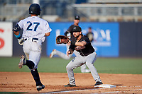 Jupiter Hammerheads first baseman Harrison Dinicola (12) waits for a throw as Wilkerman Garcia (27) runs up the base line during a Florida State League game against the Tampa Tarpons on July 26, 2019 at George M. Steinbrenner Field in Tampa, Florida.  Tampa defeated Jupiter 2-0 in the first game of a doubleheader.  (Mike Janes/Four Seam Images)