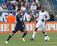 Sporting Kansas City midfielder Soony Saad (22) controls the ball at midfield.  In a Major League Soccer (MLS) match, Sporting Kansas City (blue) tied the New England Revolution (white), 0-0, at Gillette Stadium on March 23, 2013.