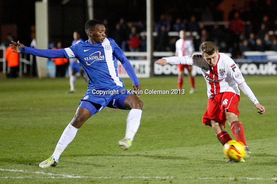 Luke Freeman of Stevenage's shot is blocked by Kgosi Ntlhe of Peterborough<br />  - Peterborough United v Stevenage - Sky Bet League One - London Road, Peterborough - 23rd November 2013. <br /> © Kevin Coleman 2013