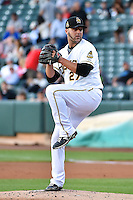 Salt Lake Bees starting pitcher Anthony Lerew (27) delivers a pitch to the plate against the New Orleans Zephyrs in Pacific Coast League action at Smith's Ballpark on August 27, 2014 in Salt Lake City, Utah.  (Stephen Smith/Four Seam Images)