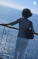 Woman looking out to sea from deck of boat, rear view (Licence this image exclusively with Getty: http://www.gettyimages.com/detail/76313997 )