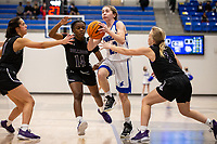 Ava Maner (23) of Rogers drives to the basket, as Wynter Beck (14) and  Claudia Bridges (1) of Fayetteville try to make stop at King Arena, Rogers, AR January 8, 2021 / Special to NWA Democrat-Gazette/ David Beach