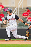 Brady Shoemaker #21 of the Kannapolis Intimidators follows through on his swing against the West Virginia Power at Fieldcrest Cannon Stadium on April 20, 2011 in Kannapolis, North Carolina.   Photo by Brian Westerholt / Four Seam Images