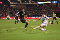 CARSON, CA - SEPTEMBER 15: Cristian Pavon #10 of the Los Angeles Galaxy crosses a ball past Graham Smith #16 of Sporting Kansas City during a game between Sporting Kansas City and Los Angeles Galaxy at Dignity Health Sports Park on September 15, 2019 in Carson, California.