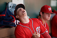 Washington Nationals Jake Randa (24) catches sunflower seeds in the dugout during an Instructional League game against the Miami Marlins on September 25, 2019 at Roger Dean Chevrolet Stadium in Jupiter, Florida.  (Mike Janes/Four Seam Images)