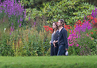 Carnell Estate - Hurlford, Scotland. Angelina Jolie and her partner Brad Pitt, who is filming World War Z in Glasgow, take a walk in the grounds of the country house. Bagpipes could be heard playing in the background as the couple strolled together. It is believed they may have been eating haggis. The pictures were taken from the public road.. Picture: Maurice McDonald/ Universal News And Sport (Scotland) 22 August 2011. www.unpixs.com..