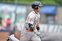 Greenville Drive third baseman Michael Chavis (11) runs to first base during a game against the Asheville Tourists at McCormick Field on July 24, 2016 in Asheville, North Carolina. The Drive defeated the Tourists 12-5. (Tony Farlow/Four Seam Images)