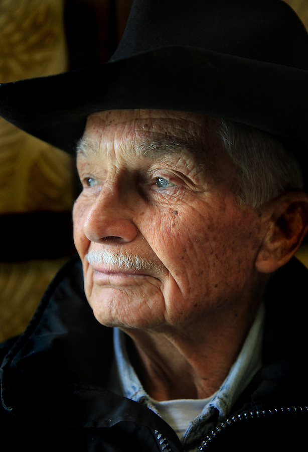 """Retired Parker Ranch manager and cowboy, Jamie Dowsett, 85, who spent most of his life on horses and has rich stories to tell, is photographed at his home in Waimea, Hi.  """"I'm 85 years old and I still think that cows and horses are the best things that ever walked on earth.  I would give anything if I could still be a cowboy...being out there on the land where nobody bothers you, out in the open where it's quiet...the horses are giving you a wonderful ride in the beautiful countryside...that is a feeling not many people have the opportunity to experience,"""" says Dowsett wistfully."""