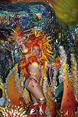 Rio de Janeiro, Brazil. Carnival: Unidos da Tijuca samba school sambista dancer on a brightly colourful float with feathers.