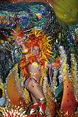 Rio de Janeiro, Brazil. Carnival: Unidos da Tijuca samba school sambista dancer on a brightly colourful float with feathers.