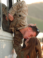 X.deploy.2.0107.jl.jpg/photo Jamie Scott Lytle/Marine Lance cpl. Benjamin A. Jones age 20 of Salt Lake City, Utah, leans out of his bus to give his wife  April Jones, age 19, a final kiss before being deployed Saturday at Camp Pendleton. The Marines are part of the 3rd Battalion, 5th Marine Regiment deploying to the Al Anbar Province in Iraq. Many of these Marine and Sailors are headed on their 3rd deployment back to Iraq.