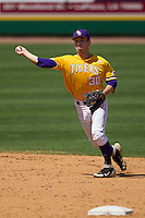 LSU Tigers shortstop Alex Bregman #30 makes a throw to first base against the Auburn Tigers in the NCAA baseball game on March 24, 2013 at Alex Box Stadium in Baton Rouge, Louisiana. LSU defeated Auburn 5-1. (Andrew Woolley/Four Seam Images).