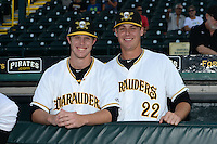 Bradenton Marauders pitchers Cody Dickson (43) and Justin Topa (22) in the dugout before a game against the St. Lucie Mets on April 11, 2015 at McKechnie Field in Bradenton, Florida.  St. Lucie defeated Bradenton 3-2.  (Mike Janes/Four Seam Images)