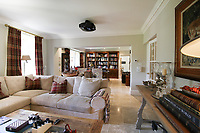 BNPS.co.uk (01202) 558833. <br /> Pic: Bidwells/BNPS<br /> <br /> Pictured: Lounge.<br /> <br /> Better than a gravy boat...<br /> <br /> A striking country house built by a bishop as a wedding gift for his son is on the market for offers over £2m.<br /> <br /> Dunbeg House sits in an incredible position on the bank of a loch with stunning panoramic water and mountain views.<br /> <br /> The impressive property not only includes the five-bedroom main house, but also a two-bedroom cottage that has been run as a successful holiday let and over four acres of woodland garden.