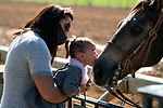 November 6, 2020: A young attendee kisses a horse's nose on the track at Keeneland Racetrack in Lexington, Kentucky, on Friday, November 6, 2020. Scott Serio/Eclipse Sportswire/Breeders Cup/CSM