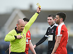 Eoin O Brien of Newmarket Celtic gets a yellow card from the referee during their Munster Junior Cup semi-final at Limerick. Photograph by John Kelly.