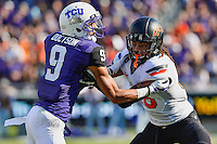 Oklahoma State cornerback Ramon Richards (18) and TCU wide receiver Josh Doctson (9) vying for position during first half of an NCAA football game, Saturday, October 18, 2014 in Fort Worth, Tex. TCU defeated Oklahoma State 42-9. (Mo Khursheed/TFV Media via AP Images)
