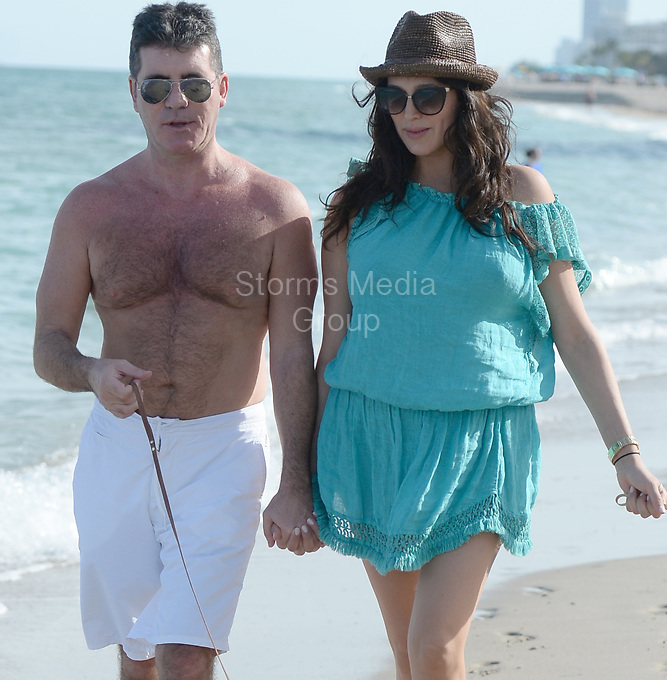 SMG_Simon Cowell_Lauren Silverman_Eric Cowell_FLXX_Adds_Newborn_Baby_022414_07.JPG<br /> <br /> MIAMI, FL - FEBRUARY 24: New parents Simon Cowell and Lauren Silverman enjoy Miami beach with their son Eric Cowell and their Yorkshire Terriers, Sqiddly and Diddly.  Cowell and Silverman welcomed their son on Valentine's Day 10 days ago. The couple was also issued a warning from police as there is no dogs allowed on the beach policy in Miami,  on February 24, 2014 in Miami, Florida. (Photo By Storms Media Group) <br /> <br /> People:  Simon Cowell_Lauren Silverman_Eric Cowell<br /> <br /> Transmission Ref:  FLXX<br /> <br /> Must call if interested<br /> Michael Storms<br /> Storms Media Group Inc.<br /> 305-632-3400 - Cell<br /> 305-513-5783 - Fax<br /> MikeStorm@aol.com<br /> www.StormsMediaGroup.com