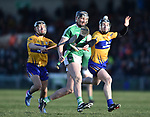 Gearoid Hegarty of  Limerick in action against David Reidy and Tony Kelly of  Clare during their NHL quarter final at the Gaelic Grounds. Photograph by John Kelly.