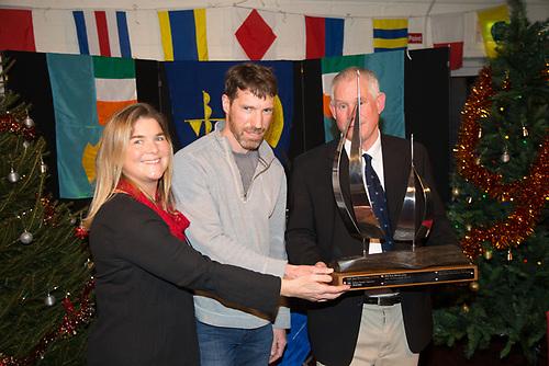 Vera Quinlan (Director of Cruising Irish Sailing Association) and Peter Owens (boat Danu) won the David Baynes Cruising Award for the best log. Presented by Johnn Shorten Commador Galway Bay Sailing Club 50th - Anniversary Awards