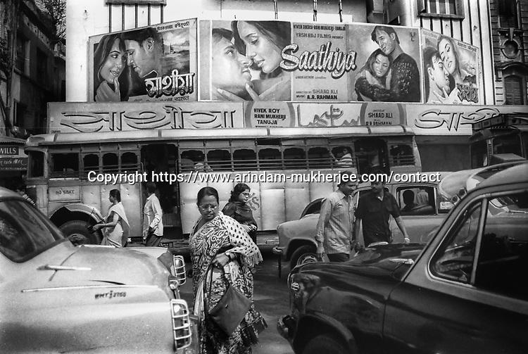 People cross busy street in Kolkata, India.
