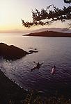 San Juan Islands, Sea kayakers landing at Clark Island Marine State Park, Salish Sea, Washington State, Pacific Northwest, U.S.A.,