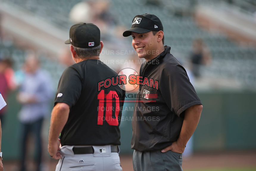 Field umpire Rene Gallegos talks with Great Falls manager Tim Esmay before a Pioneer League game between the Ogden Raptors and the Great Falls Voyagers at Lindquist Field on August 23, 2018 in Ogden, Utah. The Ogden Raptors defeated the Great Falls Voyagers by a score of 8-7. (Zachary Lucy/Four Seam Images)