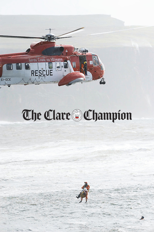 The Irish Coast Guard Sikorski Helicopter was in the Doolin area on Tuesday last when it performed a joint water rescue training exercise with members of the Doolin Coastguard. Photograph by John Kelly.