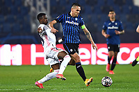 Vinicius Junior of Real Madrid and Rafael Toloi of Atalanta BC compete for the ball during the Champions League round of 16 football match between Atalanta BC and Real Madrid at Atleti azzurri d'Italia stadium in Bergamo (Italy), February, 24th, 2021. Photo Image Sport  / Insidefoto