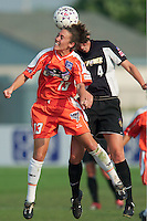 Betsy Barr of the CyberRays goes up for a header against Lauren Orlandos of the Power. The San Jose CyberRays were defeated by the NY Power 2-1 on 7/05/03 at Mitchel Athletic Complex, Uniondale, NY..