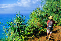 Man on the Kalalau Trail enjoys an ocean view